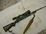 "Savage 7mm-08, Bushnell elite scope, ""custom 5 color camo"""